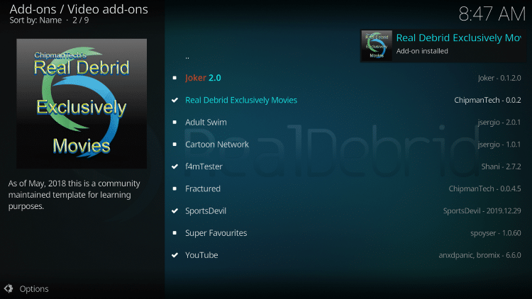 Wait a minute or two for the Real-Debrid Exclusively Movies Kodi add-on to install