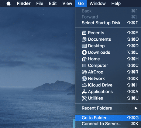 On the desktop of your Mac hover over the Go option in the upper menu and click Go to Folder.