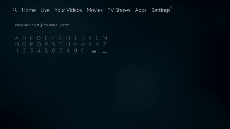 On the home screen of your Firestick/Fire TV, hover over the search icon on the left side of the menu.
